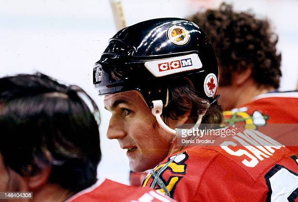 Jean Savard of the Chicago Blackhawks follows the action from the bench during a game against the Montreal Canadiens Circa 1977 at the Montreal Forum...