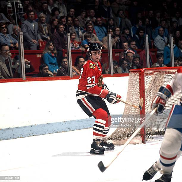 Jean Savard of the Chicago Blackhawks skates to the front of the net during a game against the Montreal Canadiens Circa 1977 at the Montreal Forum in...