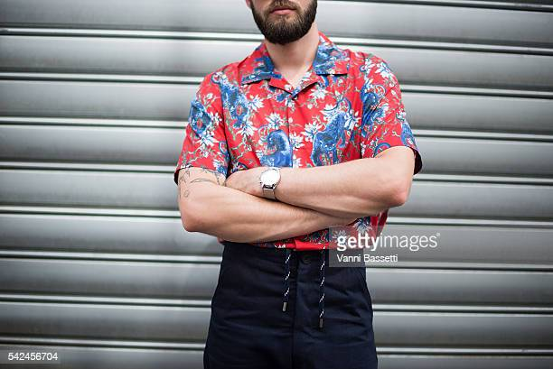 Jean Sebastien Roques poses wearin a Louis Vuitton shirt Levis pants and Valentino shoes after the Andrea Crews show at the Maison des Metallos...