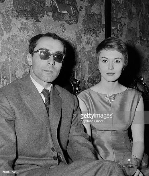 Jean Seberg and JeanLuc Godard during the party for the Premiere of the movie 'Breathless' on March 16 1960 in Paris France