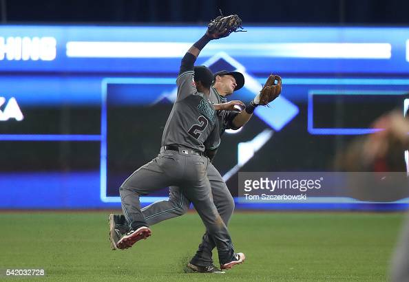 Jean Segura of the Arizona Diamondbacks catches a soft pop fly as he nearly collides with Nick Ahmed in the ninth inning during MLBgame action...