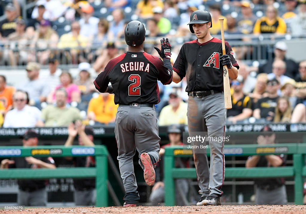 <a gi-track='captionPersonalityLinkClicked' href=/galleries/search?phrase=Jean+Segura&family=editorial&specificpeople=7521808 ng-click='$event.stopPropagation()'>Jean Segura</a> #2 of the Arizona Diamondbacks gets a high five from <a gi-track='captionPersonalityLinkClicked' href=/galleries/search?phrase=Patrick+Corbin+-+Baseball+Player&family=editorial&specificpeople=10882576 ng-click='$event.stopPropagation()'>Patrick Corbin</a> #46 after crossing home plate in the sixth inning during the game against the Pittsburgh Pirates at PNC Park on May 26, 2016 in Pittsburgh, Pennsylvania.