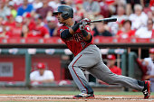 Jean Segura of the Arizona Diamondbacks hits a single during the first inning of the game against the Cincinnati Reds at Great American Ball Park on...