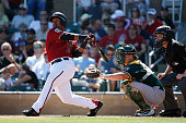 Jean Segura of the Arizona Diamondbacks hits a solo home run against the Oakland Athletics during the first inning of the spring training game at...