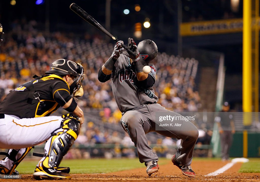 Jean Segura of the Arizona Diamondbacks is hit by a pitch in the seventh inning during the game against the Pittsburgh Pirates at PNC Park on May 24...