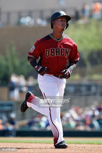 Jean Segura of the Arizona Diamondbacks rounds the bases after hitting a solo home run against the Oakland Athletics during the first inning of the...