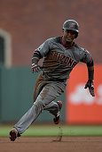 Jean Segura of the Arizona Diamondbacks runs the bases and scores on an RBI single from Paul Goldschmidt against the San Francisco Giants in the top...