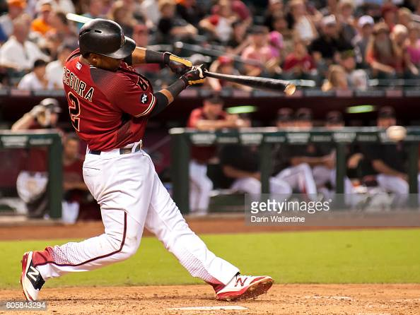 Jean Segura of the Arizona Diamondbacks singles to left field in the seventh inning of the MLB game against the San Francisco Giants at Chase Field...