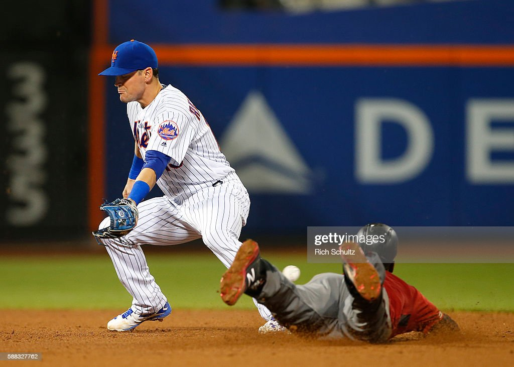 Jean Segura #2 of the Arizona Diamondbacks steals second base as shortstop Matt Reynolds #15 of New York Mets can't handle the throw in the fifth inning during a game at Citi Field on August 10, 2016 in the Flushing neighborhood of the Queens borough of New York City.