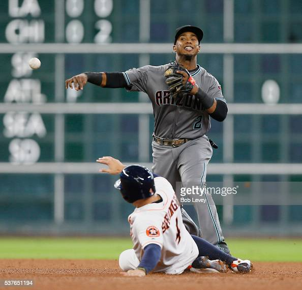 Jean Segura of the Arizona Diamondbacks throws over George Springer of the Houston Astros in the fourth inning at Minute Maid Park on June 2 2016 in...