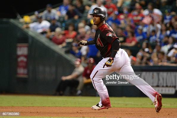 Jean Segura of the Arizona Diamondbacks watches his home run ball in flight while rounding first base in the first inning against the Los Angeles...