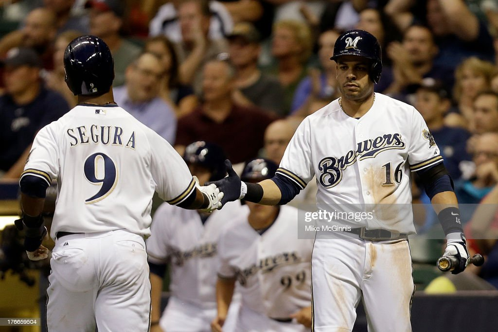<a gi-track='captionPersonalityLinkClicked' href=/galleries/search?phrase=Jean+Segura&family=editorial&specificpeople=7521808 ng-click='$event.stopPropagation()'>Jean Segura</a> #9 of the Milwaukee Brewers celebrates with <a gi-track='captionPersonalityLinkClicked' href=/galleries/search?phrase=Aramis+Ramirez&family=editorial&specificpeople=239509 ng-click='$event.stopPropagation()'>Aramis Ramirez</a> #16 after scoring on a single off the bat of Jonathan Lucroy (not pictured) in the bottom of the third inning against the Cincinnati Reds at Miller Park on August 16, 2013 in Milwaukee, Wisconsin.