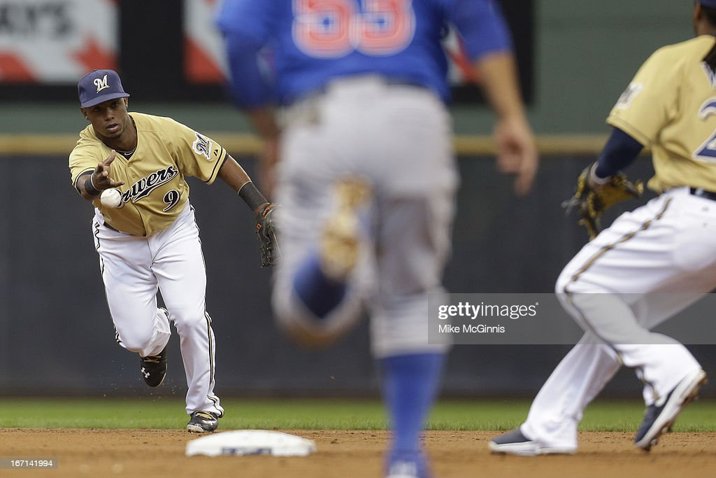 <a gi-track='captionPersonalityLinkClicked' href=/galleries/search?phrase=Jean+Segura&family=editorial&specificpeople=7521808 ng-click='$event.stopPropagation()'>Jean Segura</a> #9 of the Milwaukee Brewers flips the ball to <a gi-track='captionPersonalityLinkClicked' href=/galleries/search?phrase=Rickie+Weeks&family=editorial&specificpeople=550245 ng-click='$event.stopPropagation()'>Rickie Weeks</a> #23 at second base for the out in the top of the second inning against the Chicago Cubs at Miller Park on April 21, 2013 in Milwaukee, Wisconsin.