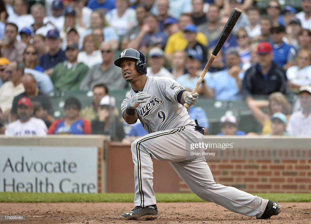 <a gi-track='captionPersonalityLinkClicked' href=/galleries/search?phrase=Jean+Segura&family=editorial&specificpeople=7521808 ng-click='$event.stopPropagation()'>Jean Segura</a> #9 of the Milwaukee Brewers follows through on an RBI double scoring teammate Norichika Aoki #7 during the seventh inning against the Chicago Cubs at Wrigley Field on July 30, 2013 in Chicago, Illinois.