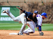Jean Segura of the Milwaukee Brewers forces out Kris Bryant of the Chicago Cubs during the third inning on May 1 2015 at Wrigley Field in Chicago...