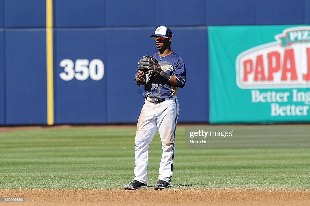 Jean Segura #9 of the Milwaukee Brewers gets ready to make a play against the Seattle Mariners at Maryvale Baseball Park on February 26, 2013 in Maryvale, Arizona.