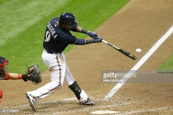 Jean Segura of the Milwaukee Brewers hits a double in the eighth inning against the St Louis Cardinals at Miller Park on April 25 2015 in Milwaukee...
