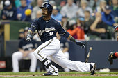 Jean Segura of the Milwaukee Brewers hits a single during the first inning against the St Louis Cardinals at Miller Park on April 25 2015 in...