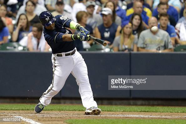 Jean Segura of the Milwaukee Brewers hits a single in the bottom of the fourth inning against the San Francisco Giants at Miller Park on August 06...