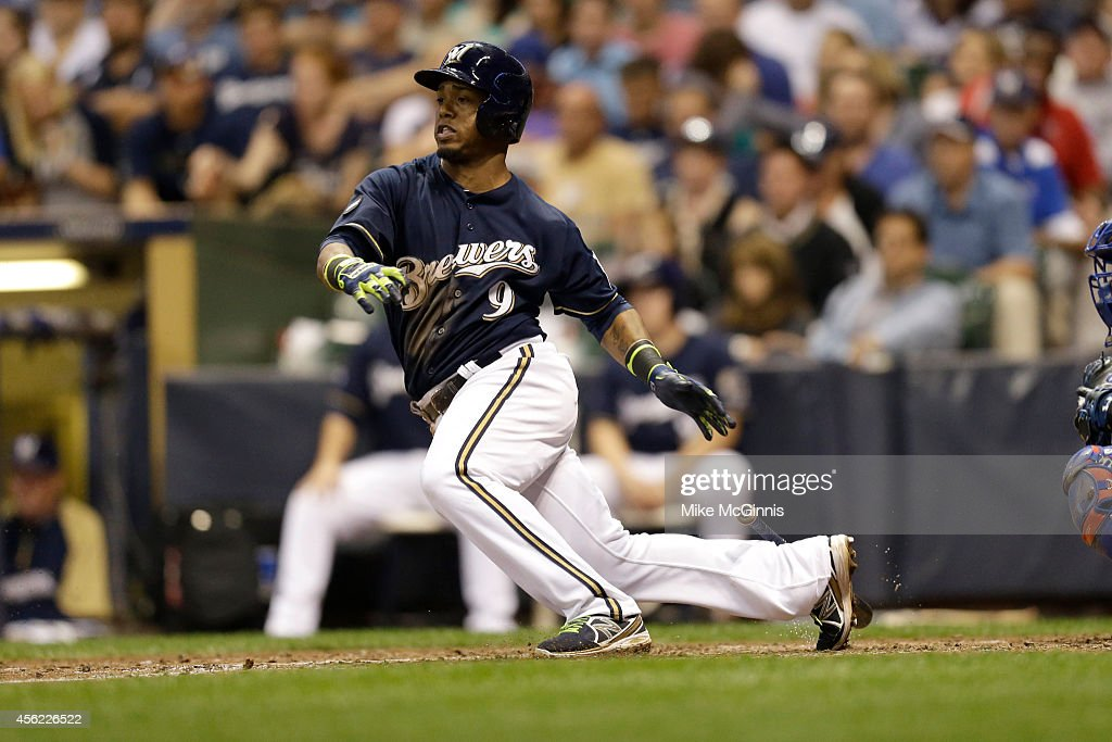 Jean Segura of the Milwaukee Brewers hits a single in the bottom of the sixth inning against the Chicago Cubs at Miller Park on September 27 2014 in...