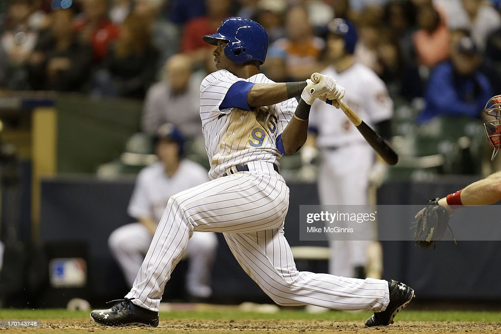 <a gi-track='captionPersonalityLinkClicked' href=/galleries/search?phrase=Jean+Segura&family=editorial&specificpeople=7521808 ng-click='$event.stopPropagation()'>Jean Segura</a> #9 of the Milwaukee Brewers hits a two-run in-the-park homer in the bottom of the seventh inning against the Philadelphia Phillies at Miller Park on June 07, 2013 in Milwaukee, Wisconsin.