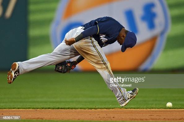 Jean Segura of the Milwaukee Brewers is unable to make a play on the ball in the first inning against the Philadelphia Phillies at Citizens Bank Park...
