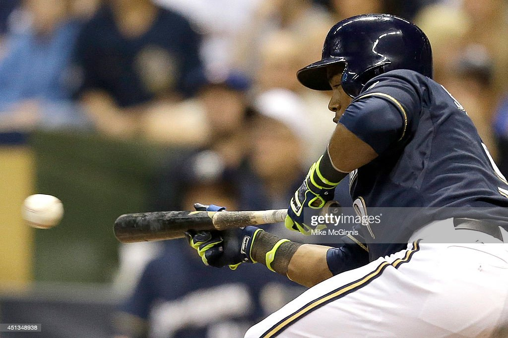 Jean Segura of the Milwaukee Brewers lays down a sacrifice bunt in the bottom of the seventh inning to move runners in scoring position against the...
