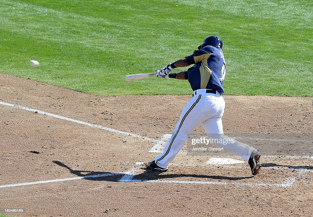 Jean Segura #9 of the Milwaukee Brewers makes a hit in the spring training game against the Oakland Athletics at Maryvale Baseball Park on February 23, 2013 in Phoenix, Arizona.