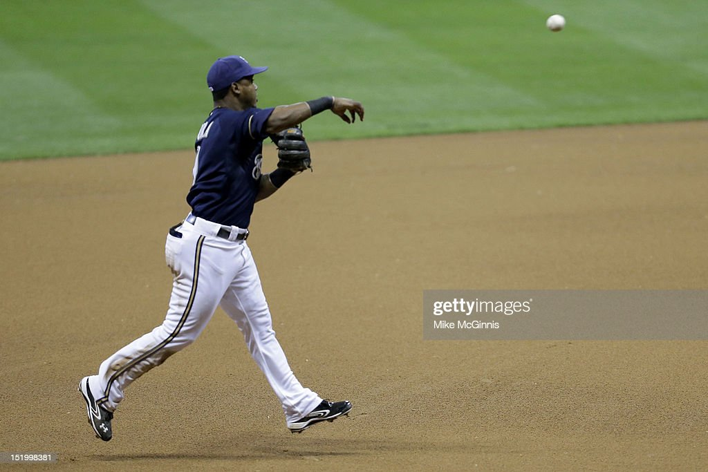 <a gi-track='captionPersonalityLinkClicked' href=/galleries/search?phrase=Jean+Segura&family=editorial&specificpeople=7521808 ng-click='$event.stopPropagation()'>Jean Segura</a> #9 of the Milwaukee Brewers makes a running throw to first base to retire Jordany Valdespin of the New York Mets in the top of the sixth inning at Miller Park on September 14, 2012 in Milwaukee, Wisconsin.