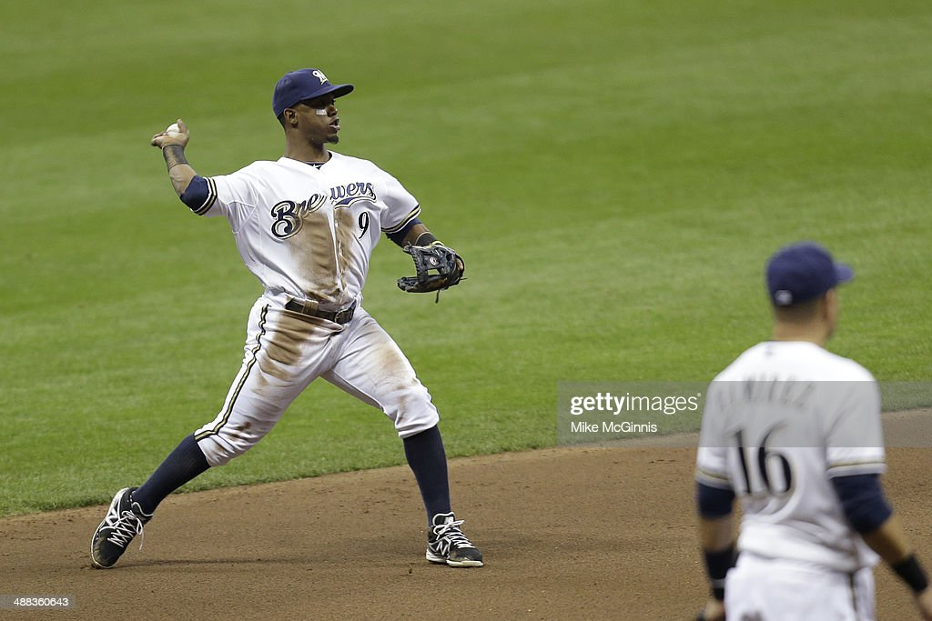 <a gi-track='captionPersonalityLinkClicked' href=/galleries/search?phrase=Jean+Segura&family=editorial&specificpeople=7521808 ng-click='$event.stopPropagation()'>Jean Segura</a> #9 of the Milwaukee Brewers makes the throw to first base to retire Mike Bolsinger (not pictured) of the Arizona Diamondbacks during the top of the fourth inning at Miller Park on April 05, 2014 in Milwaukee, Wisconsin.