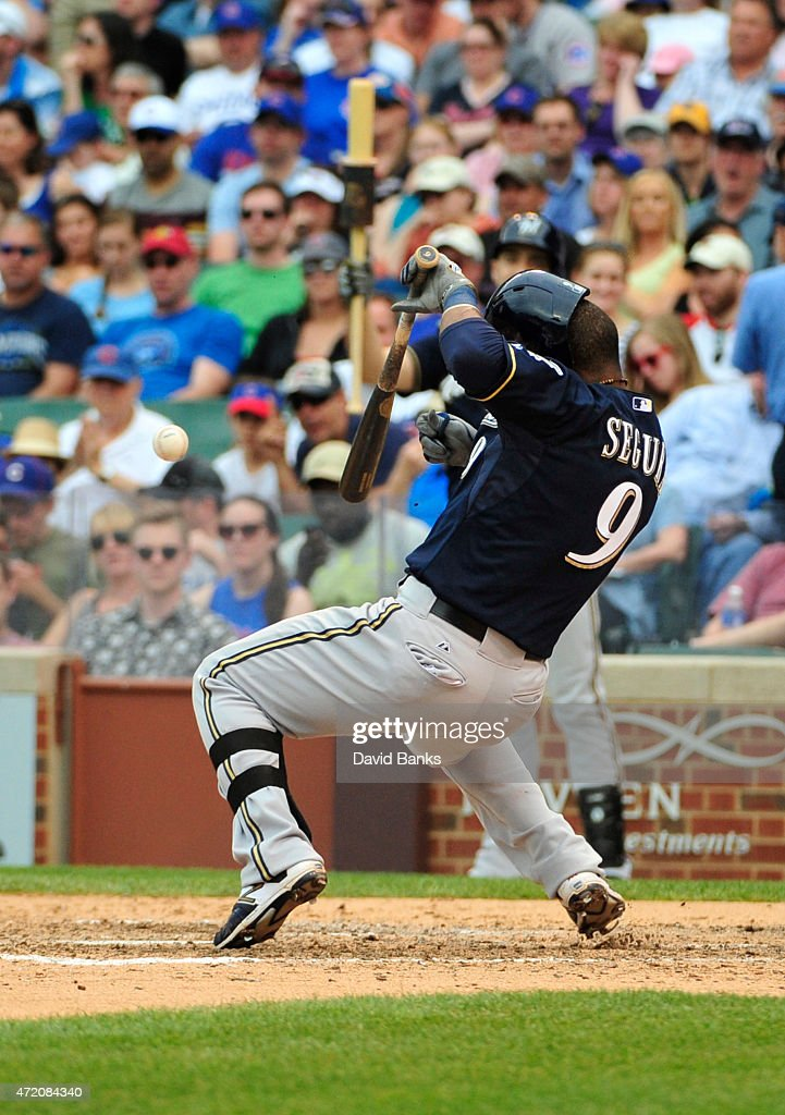 Jean Segura #9 of the Milwaukee Brewers reacts as he's hit by a pitch against the Chicago Cubs during the eighth inning on May 3, 2015 at Wrigley Field in Chicago, Illinois. The Brewers defeated the Cubs 5-3.