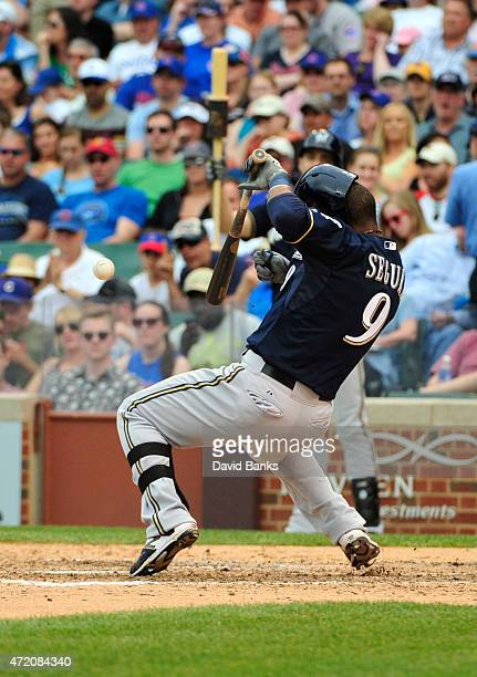 Jean Segura of the Milwaukee Brewers reacts as he's hit by a pitch against the Chicago Cubs during the eighth inning on May 3 2015 at Wrigley Field...