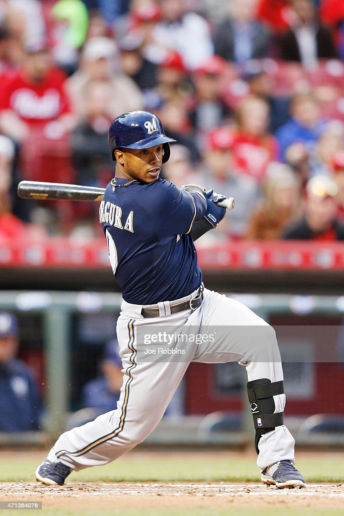 Jean Segura of the Milwaukee Brewers singles in a run in the third inning of the game against the Cincinnati Reds at Great American Ball Park on...