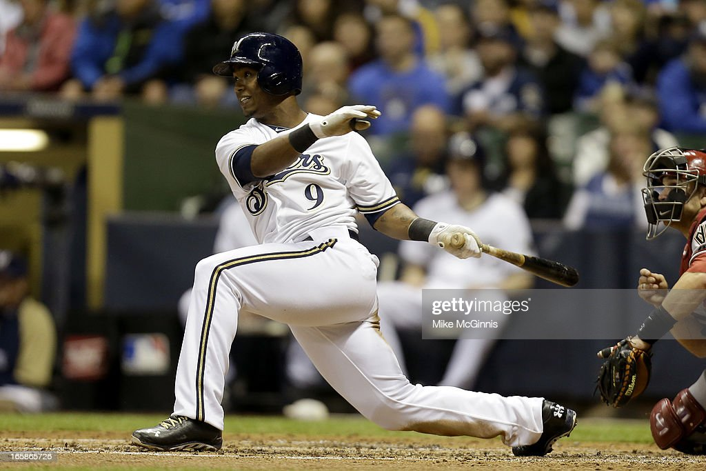 <a gi-track='captionPersonalityLinkClicked' href=/galleries/search?phrase=Jean+Segura&family=editorial&specificpeople=7521808 ng-click='$event.stopPropagation()'>Jean Segura</a> #9 of the Milwaukee Brewers singles in the bottom of the second inning scoring Khris Davis against the Arizona Diamondbacks at Miller Park on April 6, 2013 in Milwaukee, Wisconsin.