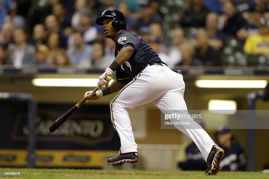 <a gi-track='captionPersonalityLinkClicked' href=/galleries/search?phrase=Jean+Segura&family=editorial&specificpeople=7521808 ng-click='$event.stopPropagation()'>Jean Segura</a> #9 of the Milwaukee Brewers singles in the bottom of the fourth inning against the Texas Ranger at Miller Park on May 07, 2013 in Milwaukee, Wisconsin.
