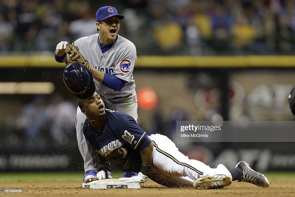 <a gi-track='captionPersonalityLinkClicked' href=/galleries/search?phrase=Jean+Segura&family=editorial&specificpeople=7521808 ng-click='$event.stopPropagation()'>Jean Segura</a> #9 of the Milwaukee Brewers slides into second base avoiding the tag from second baseman <a gi-track='captionPersonalityLinkClicked' href=/galleries/search?phrase=Darwin+Barney&family=editorial&specificpeople=537975 ng-click='$event.stopPropagation()'>Darwin Barney</a> #15 of the Chicago Cubs during bottom of the 8th inning at Miller Park on April 19, 2013 in Milwaukee, Wisconsin.