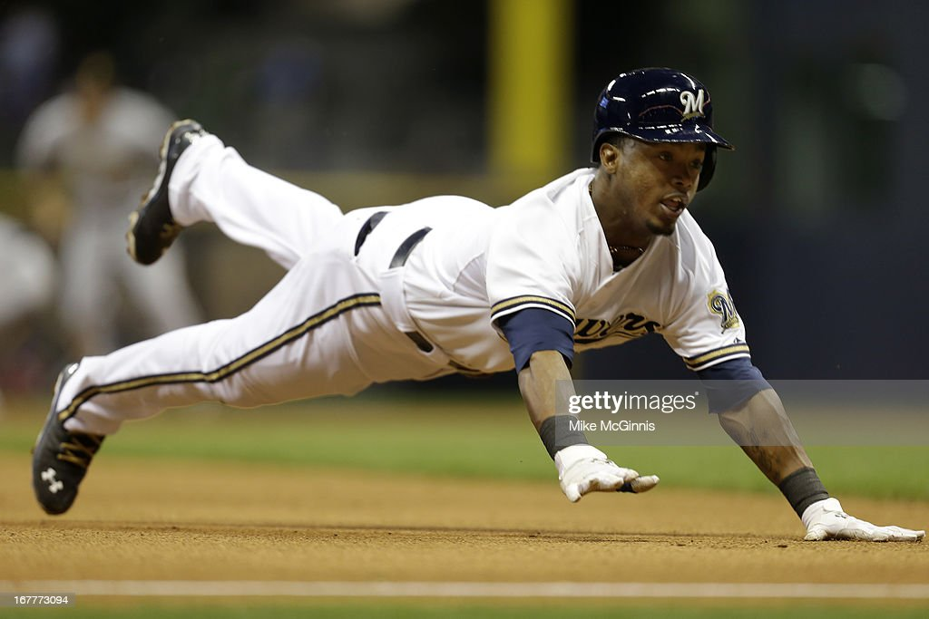 <a gi-track='captionPersonalityLinkClicked' href=/galleries/search?phrase=Jean+Segura&family=editorial&specificpeople=7521808 ng-click='$event.stopPropagation()'>Jean Segura</a> #9 of the Milwaukee Brewers slides into third base with a triple in the bottom of the sixth inning against the Pittsburgh Pirates at Miller Park on April 29, 2013 in Milwaukee, Wisconsin.