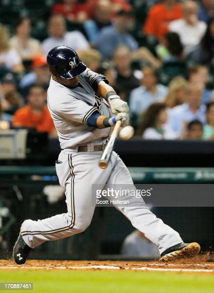 Jean Segura of the Milwaukee Brewers swings at a pitch in the fourth inning during the game against the Houston Astros at Minute Maid Park on June 19...