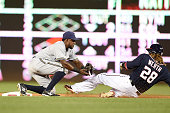 Jean Segura of the Milwaukee Brewers tags out Jayson Werth of the Washington Nationals trying to steal second base in the third inning during a...