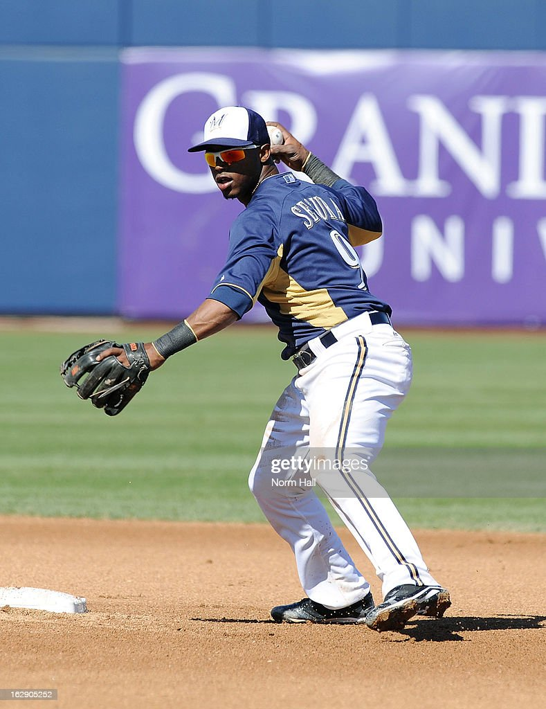 Jean Segura #9 of the Milwaukee Brewers throws the ball to first base against the Seattle Mariners at Maryvale Baseball Park on February 26, 2013 in Maryvale, Arizona.