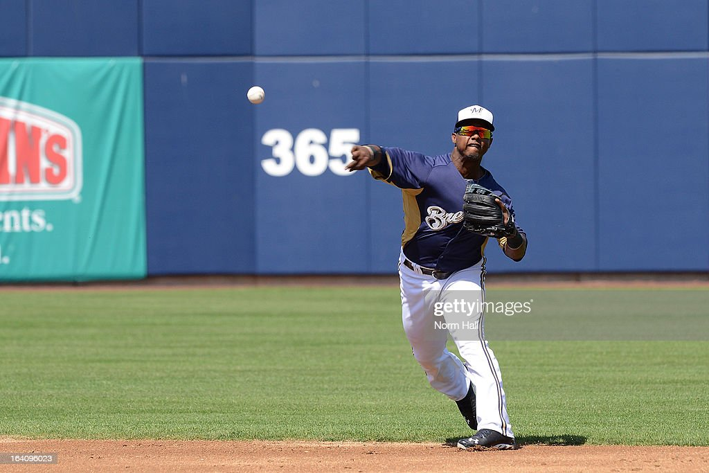 Jean Segura #9 of the Milwaukee Brewers throws the ball to first base against the Los Angeles Angels of Anaheim at Maryvale Baseball Park on March 19, 2013 in Maryvale, Arizona.