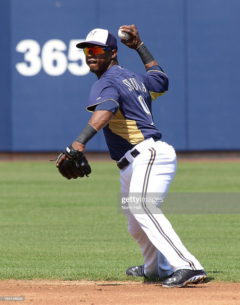 Jean Segura #9 of the Milwaukee Brewers throws the ball to first base against the Los Angeles Angels at Maryvale Baseball Park on March 19, 2013 in Maryvale, Arizona.