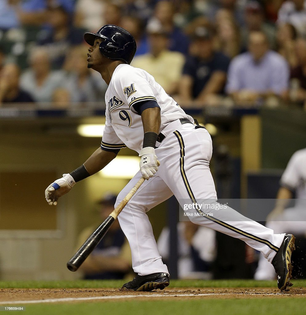 <a gi-track='captionPersonalityLinkClicked' href=/galleries/search?phrase=Jean+Segura&family=editorial&specificpeople=7521808 ng-click='$event.stopPropagation()'>Jean Segura</a> #9 of the Milwaukee Brewers triples in the bottom of the third inning against the Cincinnati Reds at Miller Park on August 16, 2013 in Milwaukee, Wisconsin.