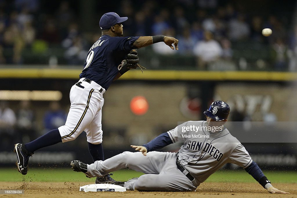 <a gi-track='captionPersonalityLinkClicked' href=/galleries/search?phrase=Jean+Segura&family=editorial&specificpeople=7521808 ng-click='$event.stopPropagation()'>Jean Segura</a> #9 of the Milwaukee Brewers turns the double play as Yasmani Grandal #12 of the San Diego Padres slides into second base during the top of the 2nd inning at Miller Park on October 1, 2012 in Milwaukee, Wisconsin.