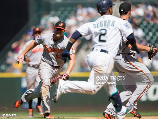 Jean Segura of the Seattle Mariners beats Chris Davis of the Baltimore Orioles for an infield single in the sixth inning at Safeco Field on August 16...