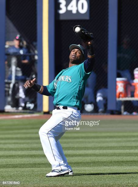 Jean Segura of the Seattle Mariners catches a pop fly in shallow left field during the third inning against the Milwaukee Brewers at Peoria Stadium...
