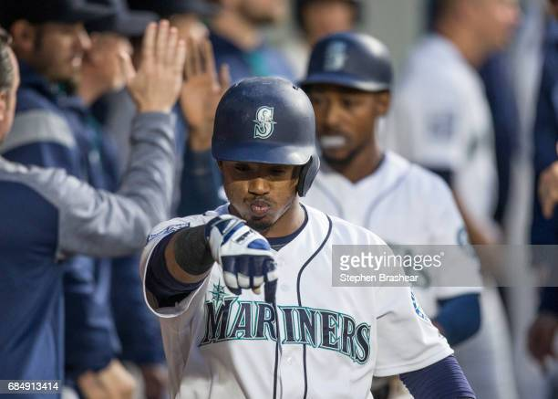 Jean Segura of the Seattle Mariners celebrates in the dugout hitting a threerun home run off of starting pitcher Dylan Covey of the Chicago White Sox...