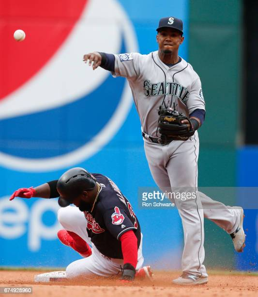 Jean Segura of the Seattle Mariners forces out Abraham Almonte of the Cleveland Indians at second base and completes the double play by throwing out...