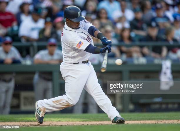 Jean Segura of the Seattle Mariners hits an RBI single off of relief pitcher Peter Moylan of the Kansas City Royals that scored Carlos Ruiz in the...