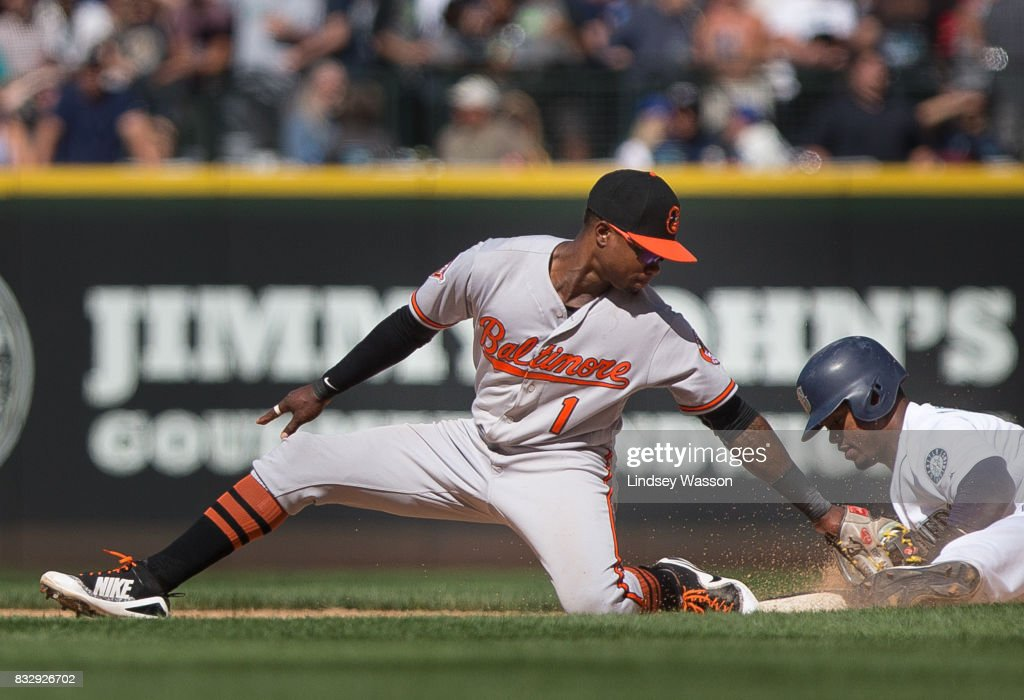 Jean Segura #2 of the Seattle Mariners is safe stealing second, beating the tag by Tim Beckham #1 of the Baltimore Orioles in the eighth inning at Safeco Field on August 16, 2017 in Seattle, Washington.